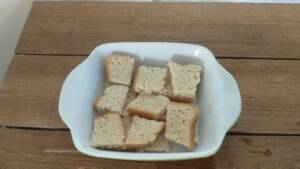 Step 3 - Arrange the bread in a baking tray