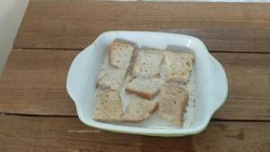 Step 4 - Pour the milk sauce over the bread