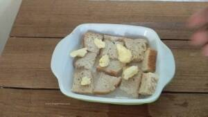 Step 5 - Add a dollap of butter over the bread