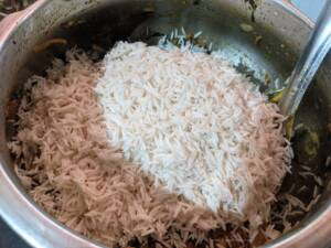 Add in the soaked Rice