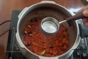Step 5 - Add in water and presuree cook the tomato thokku