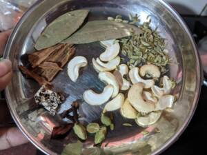 Step 1 - Add in the spices for Coconut Milk Pulao