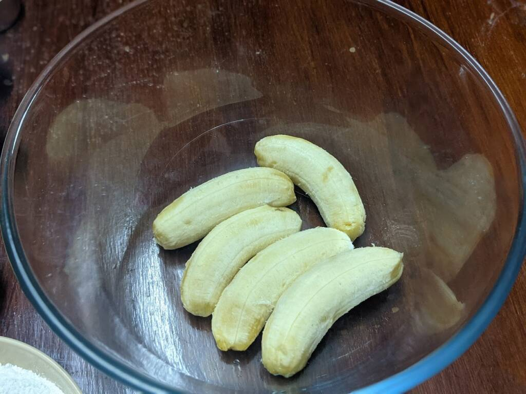 In a mixing bowl add in the ripe banana and mash well with a fork. Alternatively, you may use a masher also.