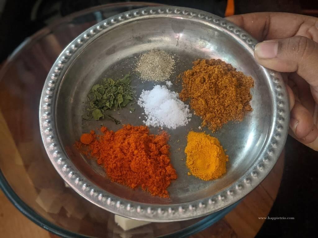 To this, add in the Red Chilli powder, Garam Masala, Cardamom powder, Salt, and Turmeric powder.